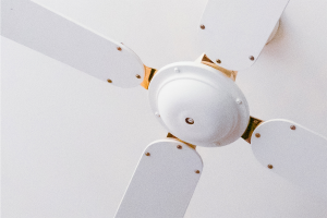 A white ceiling fan; something that can be used to save on your air conditioning bill.