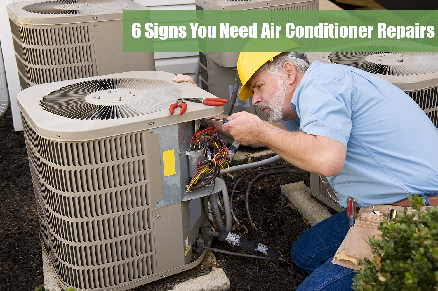 Ac technician in a blue shirt and yellow hard hat performing air conditioner repairs on an outdoor unit.